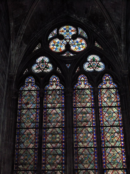 PARIS – Stain glass windows line the walls of the Notre Dame Cathedral depicting stories of numerous saints, angels and Biblical characters, along with intricate designs. Construction began in 1163, during the reign of Louis VII. (U.S. Air Force photo/Staff Sgt. Tammie Moore)