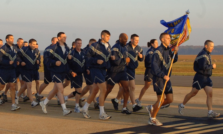Members of the 14th Secuirty Forces Squadron run in formation during the Warrior Run with their commander, Maj. Kiley Stinson, leading the way. (U.S. Air Force photo by Airman 1st Class Danielle Powell)