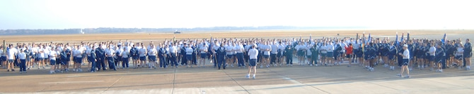 The BLAZE Team came together following the Warrior Run Nov. 20 to sing the Air Force Song. Participants ran a two mile path on the flightline. (U.S. Air Force photo by Airman 1st Class Danielle Powell)