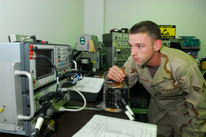 BALAD AIR BASE, Iraq -- Senior Airman Scott Gormley, a 332nd Expeditionary Maintenance Squadron avionics technician, adjusts the output power of an ultra-high frequency radio for an F-16 Fighting Falcon here, Nov. 30. The radio allows pilot to communicate with other pilots and ground personnel. Airman Gormley is deployed from Hill Air Force Base, Utah. (U.S. Air Force Photo/Staff Sgt. Joshua Garcia)