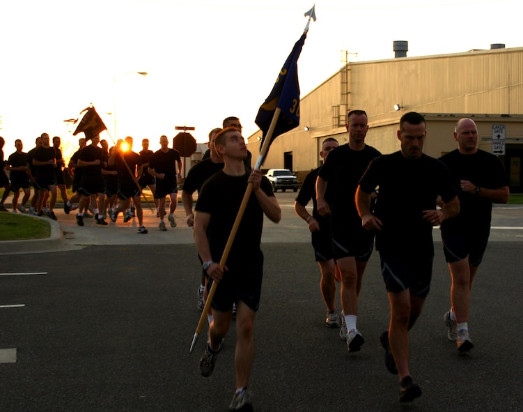 Airmen begin their 5K run as the sun rises on the second annual Prisoner of War/Missing In Action Memorial Run Sept. 28.  About 1,500 Airmen across Tinker participated in the event, which began at the POW/MIA memorial in the Tinker Air Park, wound through the base and ended on the 72nd Air Base Wing headquarters lawn.  (Photo by Staff Sgt. Stacy Fowler)