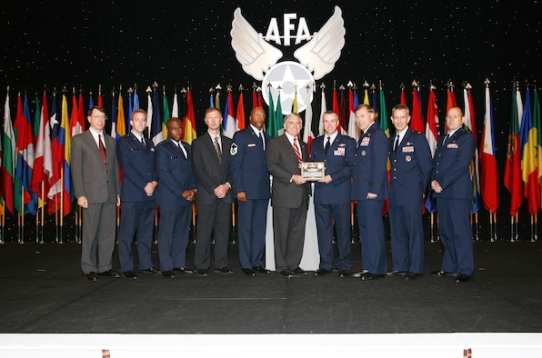 The Air Force Operational Test and Evaluation Center Small Diameter Bomb Test Team were named the Air Force Association's 2007 Test and Evaluation Team of the Year. The AFOTEC Detachment 2 team, based at Eglin AFB, Fla., received their award during the September 24-26 Air and Space Conference and Technology Exposition in Washington, D.C. Pictured from left to right are: Col. (retired) Dan Grenier, former AFOTEC Det. 2 commander; Capt. Robert Harder, team member; Capt. Craig Williams, team member; Mr. Roger Floyd, team member; MSgt. Anthony Kage, team member; Mr. Robert Largent, AFA Chairman of the Board; Col. Tom Bell, AFOTEC Det. 2 commander; Maj. Gen. Stephen Sargeant, AFOTEC commander; Col. Chris Choate, team member; and Maj. Charles Williams, team member. (Photo courtesy of the Air Force Association)
