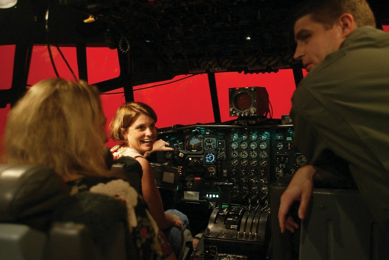 "Lisa Allen, wife of Lt. Col. Rob Allen of the 700th Airlift Squadron, has a laugh  after a ""rough landing"" that resulted in the ""red screen of death"" at the Eastern Regional Flight Simulator here. Spouses were treated to a full day of reserve life as part of the annual event meant to help reward spouses of Airmen in retention critical areas."