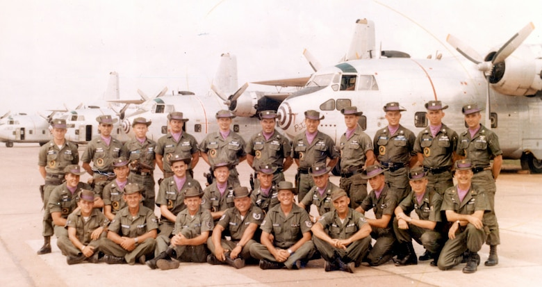 Members of Ranch Hand in 1964/1965, at a time when the program had only four C-123s. The aircraft on the right is the museum's Patches. (U.S. Air Force photo)
