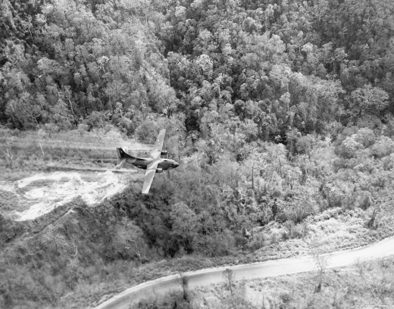 Ranch Hand UC-123 clearing a roadside in central South Vietnam in 1966. Note the aircraft's very low altitude. (U.S. Air Force photo)