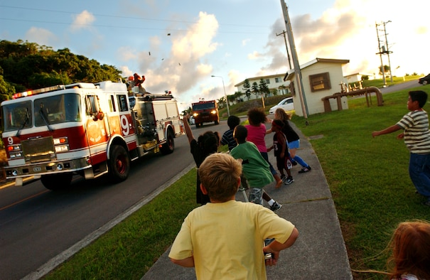 The Kadena Fire Department kicked off fire prevention weeks Oct. 1 with a parade of emergency vehicles. The parade was held to promote safety and fire prevention and was on the anniversary of the Great Chicago fire. McGruff the Crime Dog and Sparky rode around the housing area here, throwing candy to the children.  (U.S. Air Force photo/Tech. Sgt. Reynaldo Ramon)