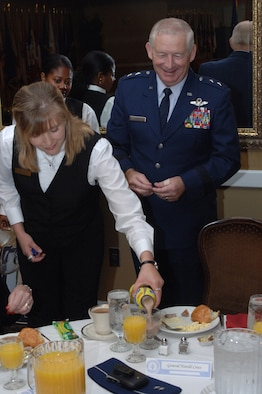 Maj. Gen. Harold Cross, Adjutant General of Mississippi, receives his a special birthday breakfast from Mary Brock, 14th Services Division, during the graduation breakfast Friday morning. General Cross was the keynote speaker for Specialized Undergraduate Pilot Training class 07-15 graduation. (U.S. Air Force photo by Senior Airman John Parie)