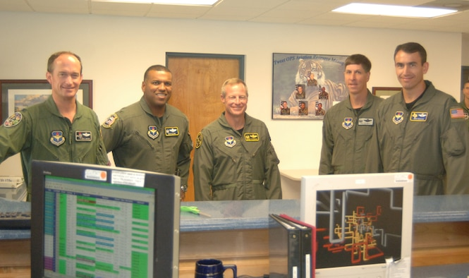 Four wing commanders visited Columbus AFB Monday through Wednesday for a Specialized Undergraduate Pilot Training commander's summit hosted by Col. Dave Gerber, 14th Flying Training Wing commander. Pictured here are: (left) Col. Gerber, Col. Richard Clark, Randolph AFB commander, Col. David Petersen, Sheppard AFB commander, Col. Richard Klumpp, Vance AFB commander, and Col. Mike Minahan, Laughlin AFB commander. (U.S. Air Force photo by Airman 1st Class Danielle Powell)