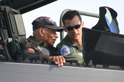 LANGLEY AIR FORCE BASE, Va. -- Dr. Roscoe Brown Jr., former captain and squadron commander of the Tuskegee Airmen's 100th Fighter Squadron of the 332nd Fighter Group watches as Maj. Paul Moga, F-22A Aerial Demonstration Team pilot, explains the inner workings of the Raptor during the Ohio air show Sept. 30. Dr. Brown was the first 15th Air Force fighter pilot to shoot down a German Me-262 jet fighter during the same mission that earned the 332nd Fighter Group the Presidential Unit Citation and was one of 51 legendary aces, veterans, WASPs and crew chiefs honored at The Gathering of Mustangs and Legends in Columbus, Ohio, Sept. 27-30. (U.S. Air Force photo/Capt. Tracy Bunko)