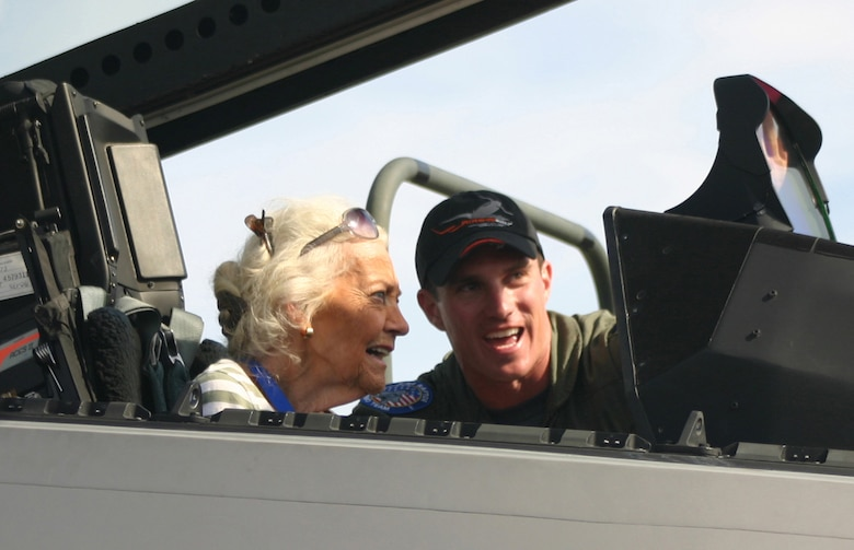 LANGLEY AIR FORCE BASE, Va. -- Ms. Betty Blake, one of the original Women Air Force Service Pilots who served during World War II, watches as Capt. Leo Lemelson, F-22A Aerial Demonstration Team safety observer, explains the inner workings of the Raptor during the Ohio air show Sept. 30. According to Ms. Blake's son, George, she started flying at 14 without her parents' knowledge because they wouldn't have allowed her to be a pilot. Ms. Blake spent all four years of the war as a transport pilot ferrying 36 different types of aircraft including the P-51. Ms. Blake was one of 51 legendary aces, veterans, WASPs and crew chiefs honored at The Gathering of Mustangs and Legends in Columbus, Ohio, Sept. 27-30. (U.S. Air Force photo/Capt. Tracy Bunko)