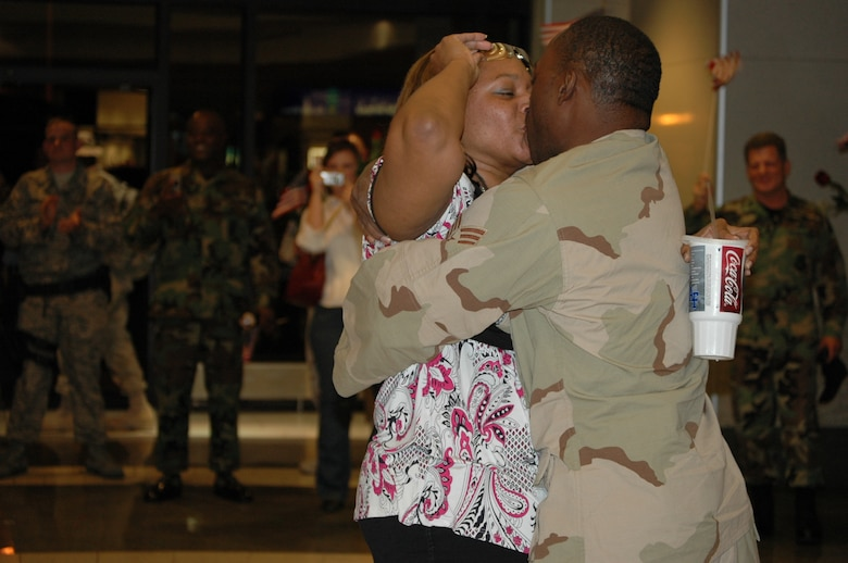 HILL AIR FORCE BASE, Utah-- Staff Sgt. Issac Jones, 75th Security Forces Squadron, give a long over due kiss to his wife, during his homecoming at the Salt Lake City International Airport Oct. 2. The 45 Airmen returned from a seven month deployment in Bucca, Iraq. (U.S. Air Force photo by Capt. Gena David)
