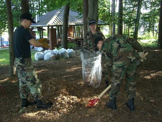 """Personnel from the 426th Information Operations Squadron recently demonstrated their """"commitment to excellence"""" by banding together and adopting a piece of Vogelweh land."""