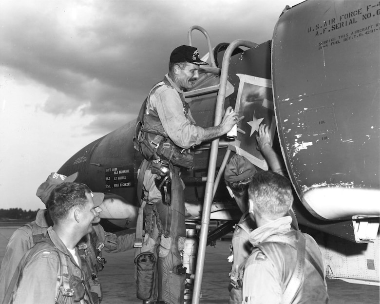 Col. Robin Olds painting a victory star on the F-4 he was flying on May 4, 1967, when he shot down a MiG-21. (U.S. Air Force photo)