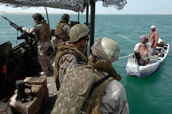 u s department of > photos > photo essays > essay view navy petty officer 1st class garrick a bowles and an interpreter warn local fishermen on