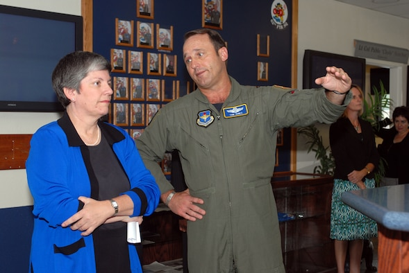 Arizona Gov. Janet Napolitano listens as Brig. Gen. Tom Jones, 56th Fighter Wing commander, explains Luke's mission while touring the 62nd Fighter Squadron. She was visiting the base as part of her trip through the West Valley Monday. She was the guest of honor at a reception at Luke during which she addressed West Valley veterans, business and community leaders, and Luke Airmen. (photo by Airman 1st Class David Bulkley)