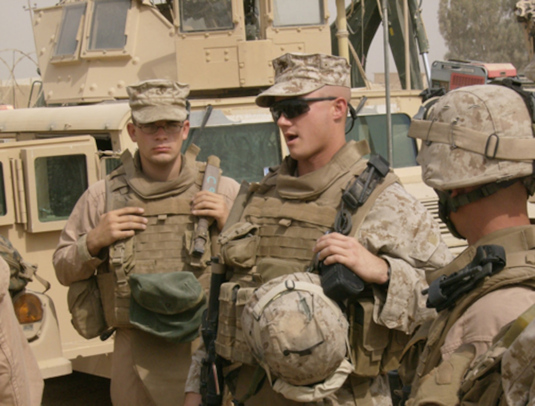 CAMP RAMADI, IRAQ (OCTOBER 6, 2007)—First Lt. Jeromy Johnson, executive officer, Headquarters and Service Company, 1st Battalion, 8th Marine Regiment, currently attached to the U.S. Army's 1st Brigade Combat Team, 3rd Infantry Division, Multi National Force-West, briefs Marines of the battalion's military police transition team before a convoy into Ar Ramadi.  The team's mission is to work with Iraqi security forces in joint security operations (Official U.S. Marine Corps photo by Lance Cpl. David A. Weikle).