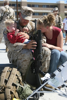 Cpl. Matthew Beaudin, a fire direction control man with India Battery, 3/11, says goodbye to his wife, Kristie, and son, Matty, before departing the Combat Center Monday.