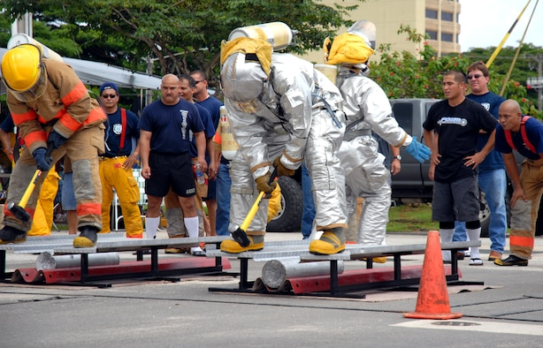 ANDERSEN AFB, GUAM---Firefighter, Eric Masur , 36th Civil Engineering Squadron, participates in the team relay portion of the 2nd Annual Island-Wide Firefighter Muster that was held at the Agana Shopping Center, October 6, 2007, in conjuction with Fire Prevention Week.  Mr. Masur  placed first in the solo relay event.  Andersen's Firefighters placed second overall for both days that the event was held.(U.S. Air Force photo by Senior Airman Miranda Moorer)(RELEASED)