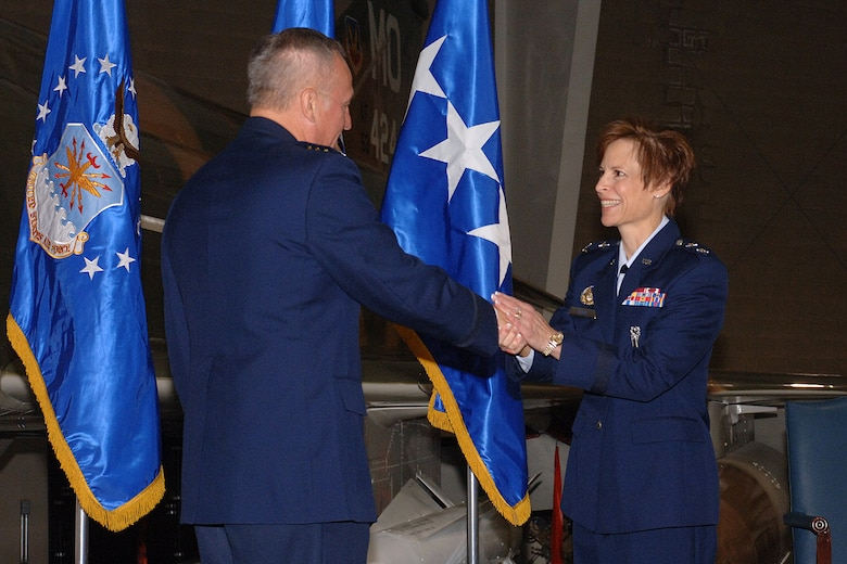 HILL AIR FORCE BASE, Utah-- Gen. Bruce Carlson, commander of the Air Force Material Command, congratulates Maj. Gen. Kathleen Close, Ogden Air Logistics Center commander, during her promotion ceremony, Oct. 4. General Carlson presided the ceremony and administered the oath.(U.S. Air Force photo by Alex R. Lloyd)