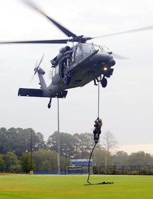"Marietta High School hosted the first ""High School Drop-In"" event during Air Force Week Atlanta, Oct. 8-14. The helicopter pararescue demonstration was performed by the 301st Rescue Squadron, Patrick AFB, Fla. The aircraft used in the demonstration is the HH-60 Pavehawk. ""This demonstration was an alternate infiltration/exfiltration exercise,"" said Master Sgt. Steve Johnson, the Pavehawk's flight engineer. The exercise demonstrated the capability of the pararescueman to retrieve a survivor by hoist. The rescue demonstration is part of the  Air Force ""Heritage to Horizons"" 60th Anniversary. (U.S. Air Force photo/Don Peek)"