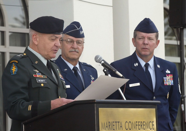 Maj. Gen. William Nesbitt, Georgia Assistant Adjutant General, reads the proclamation designating Oct. 8-14 as Air Force Week Atlanta during a ceremony at the Marietta Conference Center Oct. 8 as Maj. Gen. Martin Mazick, 22nd Air Force commander, and Chief Master Sgt. of the Air Force Rodney McKinley look on.  Nearly 100 people attended the ceremony, which featured remarks by Georgia Congressman Phil Gingrey and an oath of enlistment for a dozen high school students.  Air Force Week is designed to inform the American public, civic leaders and service members about the Air Force's mission, 60-year heritage, capabilities and role in the Global War on Terror.