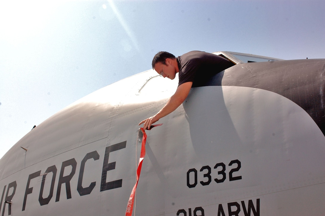 Senior Airman Mike McGovern places a cover on an air data probe of a KC-135 Stratotanker in Southwest Asia. The cover prevents foreign objects from damaging and plugging the probe so pilots receive accurate information. Airman McGovern is deployed to the 340th Aircraft Maintenance Unit from Grand Forks Air Force Base, N.D. (U.S. Air Force photo/Staff Sgt. Jason Barebo)