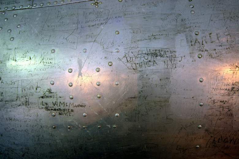 "DAYTON, Ohio (07/2007) -- The B-17F ""Memphis Belle"" in restoration at the National Museum of the U.S. Air Force. This photo shows some of the graffiti on the aircraft. (Photo courtesy of Craig Scaling, Airshow Traveler)"
