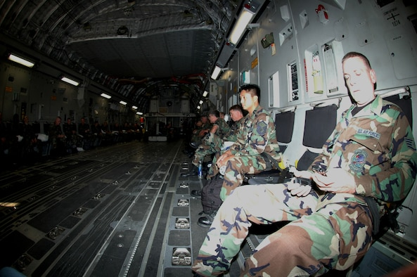 CE MEMBERS DEPLOY FOR SILVER FLAG -- Members of the 439th Civil Engineering Squadron sit aboard a C-17 Globemaster III Oct. 6 at Westover for a flight to Dobbins Air Reserve Base, Ga. The reservists are participating in Silver Flag, one of the largest Air Force exercises in the United States. More than 50 reservists from Westover are involved. The second week of the exercise takes place at Tyndall Air Force Base, Fla.