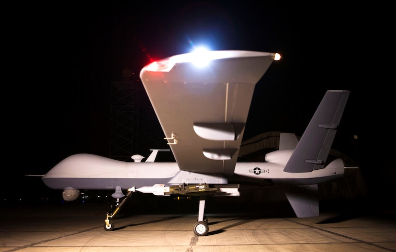 An MQ-9 Reaper sits on a ramp in Afghanistan Oct. 1. The Reaper is launched, recovered and maintained at deployed locations, while being remotely operated by pilots and sensor operators at Creech Air Force Base, Nev.  (Courtesy photo)