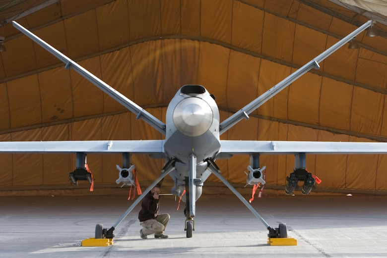 A maintenance Airman inspects an MQ-9 Reaper in Afghanistan Oct. 1. Capable of striking enemy targets with on-board weapons, the Reaper has conducted close air support and intelligence, surveillance and reconnaissance missions. (Courtesy photo)
