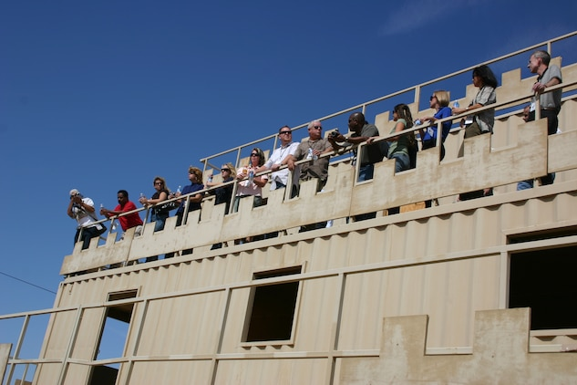 Sponsors who attended the annual Marine Corps Community Services sponsorship tour admire the Combat Center's mock Iraqi village called Combat Center Range 215 from the balcony of a second-story building Oct. 12.