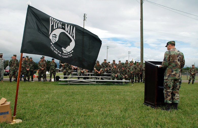 SOTO CANO AIR BASE, Honduras – Following the completion of a 24-hour Prisoner of War/Missing in Action Remembrance Run, Air Force Col. Howard Jones, Joint Task Force-Bravo deputy commander, delivers a speech explaining the importance of remembrance.  A total of approximately 170 participants ran in mostly 15-minute intervals for 24 hours to show support for their fellow servicemembers who have been listed as POW/MIA.  (U.S. Air Force photo by Staff Sgt. Austin M. May)