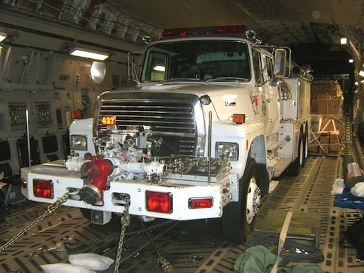 A donated fire truck was picked up in Klamath Falls, Ore., Oct. 5 by an Air Force Reserve aircrew from the 446th Airlift Wing, McChord Air Force Base, Wash. The Reservists flew the fire truck, as well as 100 pediatric wheelchairs picked up in Sioux Falls, Iowa, on the first leg of a Denton Program mission.  The fire truck was destined for Nicaragua and the wheelchairs were bound for Iraq. (U.S. Air Force photo/Maj. Jon Karnes)
