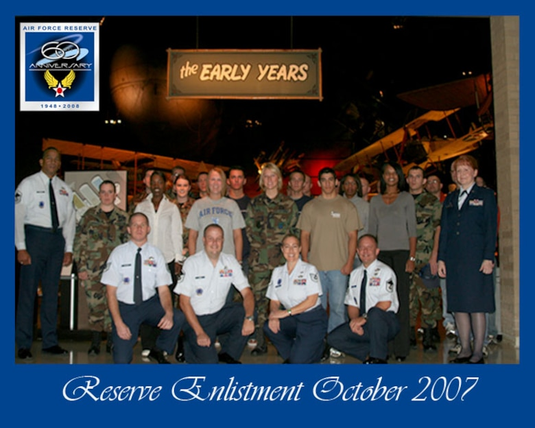 WRIGHT-PATTERSON AFB, Ohio -- Air Force Reserve recruiters along with Col. Mary Henderhan, commander of the 445th Mission Support Group (left) stands with 32 new recruits and enlistees for the 445th Airlift Wing in front of the early year's exhibit inside the National Museum of the United States Air Force.  Colonel Henderhan did a mass enlistment for the recruiters October 13 to start the new fiscal year 2008 enlistment drive.  This was one of many events to highlight the U.S. Air Force Reserve Command's 60th Anniversary.  (U.S. Air Force photo/SrA Ken LaRock)
