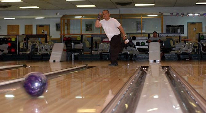 Charlie Alonga hurls his bowling ball down a lane at Travis Bowling Center. Travis' Bowling Center has one of the highest number of lines, which are the number of individuals playing a game, in the Air Force. (U.S. Air Force photo/Nick DeCicco)