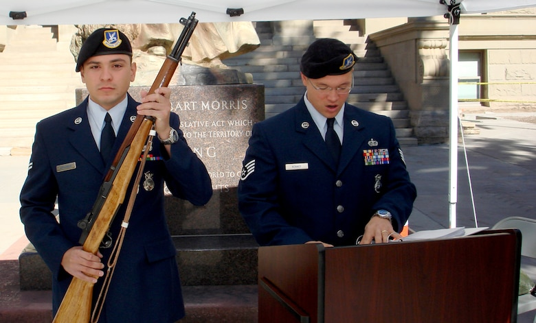 Airman 1st Class Wesley Arrambide, 90th Missile Security Forces Squadron, positions himself as the sentry while Staff Sgt. Justin Kenney, 90th MSFS, reads the names of prisoners of war and people missing in action during the 24 hour vigil for the National POW/MIA Recognition Day Sept. 21 at the state capital (Courtesy photo).