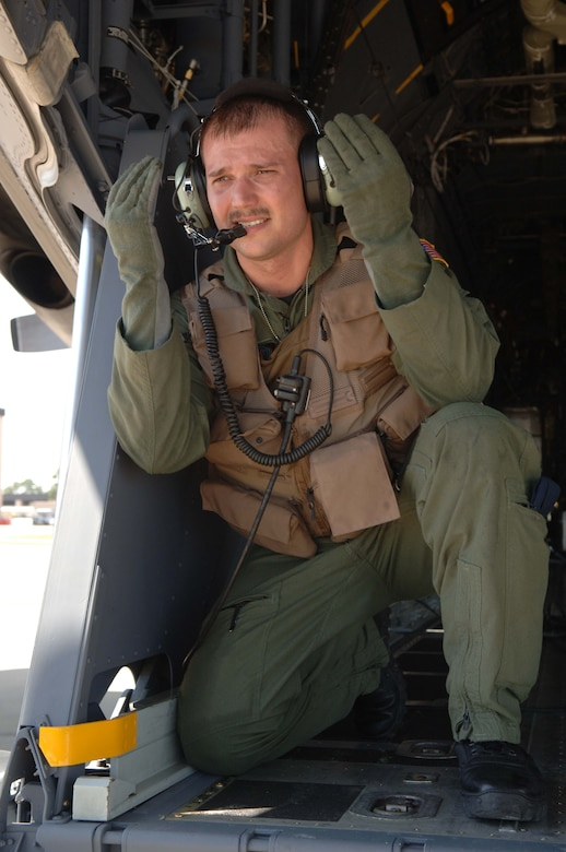 """Staff Sgt. Kenneth Webb, 15th Special Operations Squadron loadmaster, is featured in the second volume of the Air Force Chief of Staff's """"Portraits in Courage"""" book. While returning from a mission in Iraq, a fire broke out in the cargo compartment of Sergeant Webb's C-130 with 30 passengers aboard. He reacted quickly to revive two uncounscious passengeres and save the lives of the rest of those around him. He is one of 13 Airmen featured in the book."""