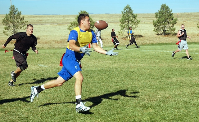 SCHRIEVER AIR FORCE BASE, Colo. -- Tyler Kimes of 4th SOPS makes a catch near the goal line during the intramural flag football championship Oct. 12. The completion set 4th SOPS up for a touchdown on its next play, but 50th SCS carried the game 19-14. (U.S. Air Force photo/Lorna Gutierrez)