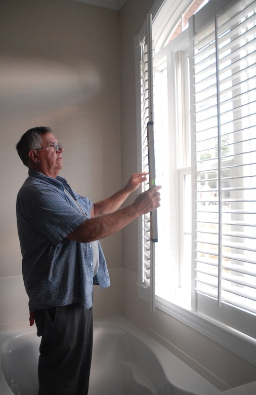 Ken Hoeft, contractor from K-N-K Industries in Michigan, measures blinds in one of the newly constructed houses on base Monday. The home is part of the Family Housing Phase IV construction project on base. (U.S. Air Force photo/Staff Sgt. Jennifer Arredondo)