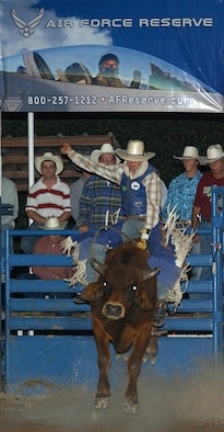 """The Air Force Reserve was one of the sponsors for the 2007 Ride for the Brand Rodeo in Helotes, Texas. Chance Glocar goes for an """"Eight Second Ride"""" in the bull riding portion of the Ride For the Brand Rodeo October, 6 in Helotes Texas. The 3-day annual event is sponsored by a committee made up of reservists from the 433rd Airlift Wing, Lackland Air Force Base, Texas, neighboring military units and veterans. Procedes from the rodeo will help local schools, provide scholarships to area high school seniors and to military members and their families. (U.S. Air Force Photo/Alan Boedeker)"""