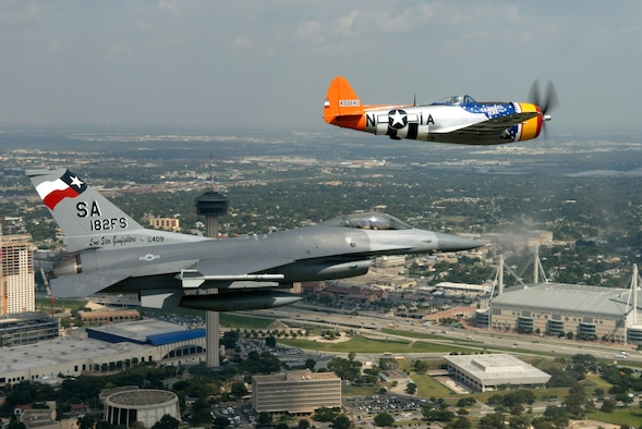 A vintage P-47 Thunderbolt and an F-16 Fighting Falcon perform a heritage flight together over San Antonio Oct. 11 as part of the 182nd Fighter Squadron's 60th anniversary celebration. The squadron, which belongs to the Texas Air National Guard 149th Fighter Wing, traces its heritage to the 396th Fighter Squadron, which flew P-47s in combat during World War II. For the Oct. 11 flight, Robbie Vajdos, of Louise, Texas, flew the P-47 from the Lone Star Flight Museum, in Galveston, Texas. Lt. Col. John Kane of the 182nd FS piloted the F-16. (U.S. Air Force photo by Senior Master Sgt. Mike Arellano)