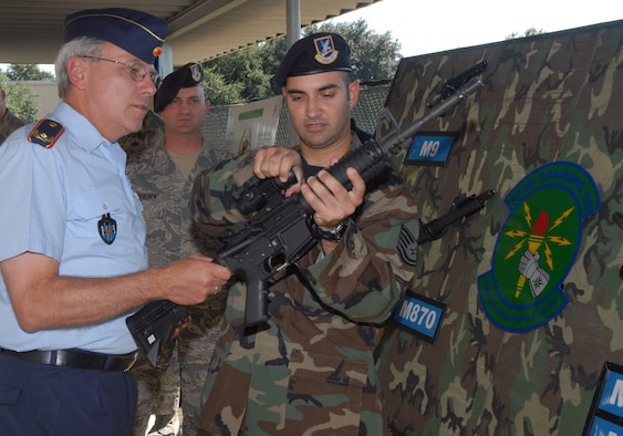Tech. Sgt. Ian Mirkes shows German Air Force Brig. Gen. Gerd Bischof the components of an M-4 rifle during the general's tour of the 342nd Training Squadron's Combat Arms Training and Maintenance operations Oct. 12 at Lackland Air Force Base, Texas. (Photo by Rich McFadden)