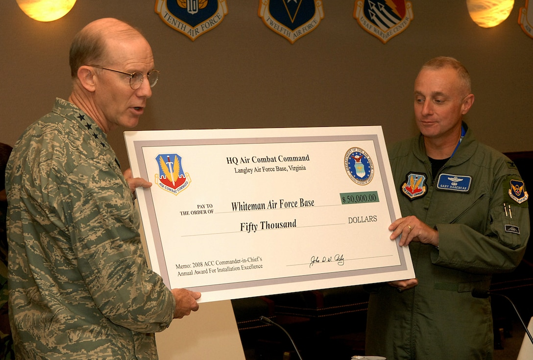 Left to right: Gen. John Corley, Air Combat Command commander with headquarters at Langley Air Force Base, Va., presents a check for $50,000 to Col. Garrett Harencak, 509th Bomb Wing commander, at the ACC commander's conference Oct. 12. Whiteman received the money in recognition of being named ACC's runner-up in the 2008 Commander in Chief's Installation Excellence Award installation category. The money will be used for quality of life improvements.  (U.S. Air Force photo/Senior Airman Cecil McCloud)