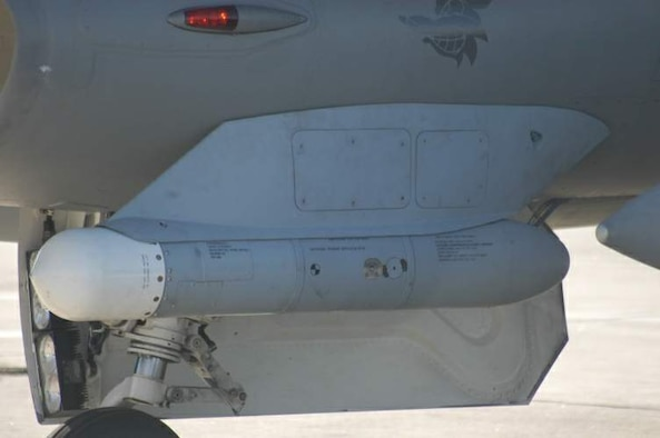 The High-speed Anti-Radiation Missile Targeting System, or HTS, loaded on the F-16CJ Block 50/52 Fighting Falcon at Langley Air Force Base, Va. (Courtesy photo)