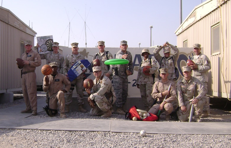 Airmen from the 586th, 886th, and 887th Security Forces Squadrons, including Senior Master Sgt. Timothy Spradlin, 445th Civil Engineer Squadron, Wright-Patterson AFB, Ohio, (standing 3rd from left) display the sports equipment which members of the wing collected and sent to them for their enjoyment while deployed down range. (Courtesy photo)
