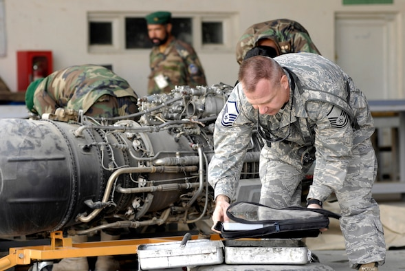 Master Sgt. George Lewandowski looks over a tool kit created for the Afghan national army air corps aircraft maintenance section Oct. 18 at Kabul Air Field, Afghanistan. The kits help the maintainers keep track of their tools as well as aid in engine safety. Sergeant Lewandowski, an ANA air corps mentor, is a precision measurement equipment laboratory Airman in charge of the tool accountability program at Kabul International Airport. He is deployed here from Eglin Air Force Base, Fla. (U.S. Air Force photo/Staff Sgt. Brian Ferguson)