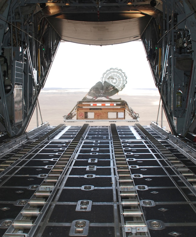 A cargo pallet drops from a C-130 aircraft during a training flight Oct. 7. The pallet is released from the aircraft when a connected parachute is deployed and catches winds out the back.