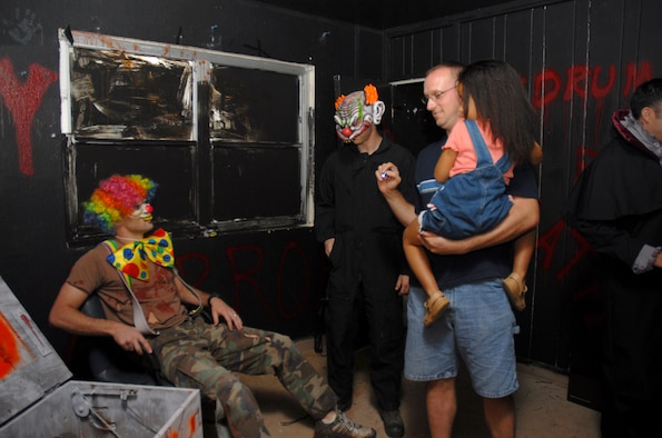 Tech. Sgt. Martin Pitre and his daughter check out the 36th Civil Engineering Squadron's haunted house in base housing Oct. 20.  (U.S. Air Force photo/Senior Airman Miranda Moorer)