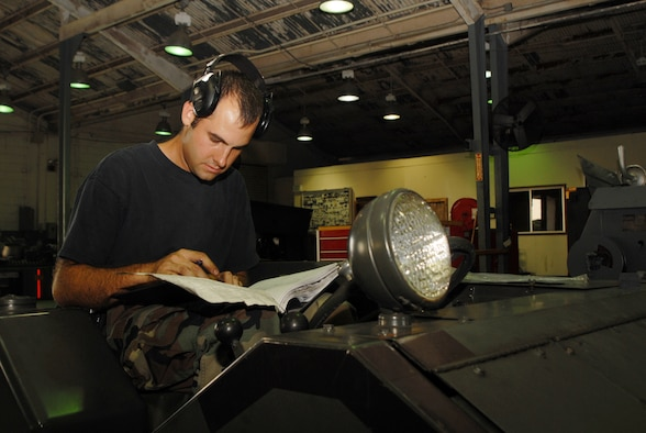 Staff Sgt. Christopher Pugh, 18th Equipment Maintenance Squadron, troubleshoots and documents maintenance forms for a piece of aircraft ground equipment during Local Operational Readiness Exercise Beverly High 08-1 Oct. 22. (U.S. Air Force photo/Staff Sgt. Chriss FitzGerald)