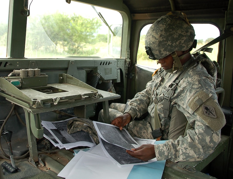 SOTO CANO AIR BASE, Honduras – Army Staff Sgt. Alma Jennings, truck commander for a Humvee leading one group of vehicles in a convoy exercise Oct. 19, checks her route on a map as the convoy rolls toward the village of Lejamani.  The purpose of the training was to keep the vehicles in operation and identify any issues with them so they could be fixed.  (U.S. Air Force photo by Staff Sgt. Austin M. May)